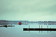 Floating Sauna on the Lake near Ed, Sweden. Shot during light rain jusr after sunset. <br /> Available as print of license to use.