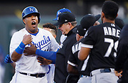 Kansas City Royals' Salvador Perez (13) exchanges words with Chicago White Sox' Jose Abreu (79) at second base as the benches clear in the first inning of a baseball game at Kauffman Stadium in Kansas City, Mo., Saturday, April 28, 2018. (AP Photo/Colin E. Braley)