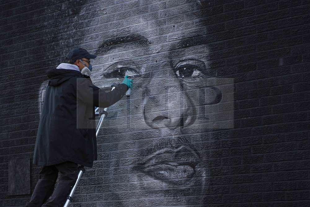 © Licensed to London News Pictures. 10/11/2020. Manchester, UK. Street Artist, Akse, puts the finishing touches to his mural of Manchester United striker, Marcus Rashford in Manchester. The work has been created as part of a local community art project, Withington Walls. Photo credit: Ioannis Alexopoulos/LNP