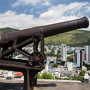 View of the capital city of Port Louis from the Citadel Fort Adelaide with a cannon in the foreground
