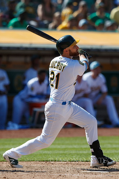 OAKLAND, CA - JUNE 17: Jonathan Lucroy #21 of the Oakland Athletics hits a walk off RBI single against the Los Angeles Angels of Anaheim during the eleventh inning at the Oakland Coliseum on June 17, 2018 in Oakland, California. The Oakland Athletics defeated the Los Angeles Angels of Anaheim 6-5 in 11 innings. (Photo by Jason O. Watson/Getty Images) *** Local Caption *** Jonathan Lucroy