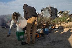 """Calais, Pas-de-Calais, France - 16.10.2016    <br />     <br /> Syrian refugees from Dar?? in the """"Jungle"""" camp on the outskirts of the French city of Calais. Many thousands of migrants and refugees are waiting in some cases for years in the port city in the hope of being able to cross the English Channel to Britain. French authorities announced that they will shortly evict the camp where currently up to up to 10,000 people live.<br /> <br /> Syrische Fluechtlinge aus Dar?? im """"Jungle"""" Fluechtlingscamp am Rande der franzoesischen Stadt Calais. Viele tausend Migranten und Fluechtlinge harren teilweise seit Jahren in der Hafenstadt aus in der Hoffnung den Aermelkanal nach Großbritannien ueberqueren zu koennen. Die franzoesischen Behoerden kuendigten an, dass sie das Camp, indem derzeit bis zu bis zu 10.000 Menschen leben Kürze raeumen werden. <br /> <br /> Photo: Bjoern Kietzmann"""