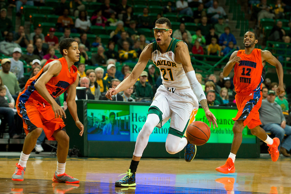 WACO, TX - JANUARY 3: Isaiah Austin #21 of the Baylor Bears brings the ball up court against the Savannah State Tigers on January 3, 2014 at the Ferrell Center in Waco, Texas.  (Photo by Cooper Neill) *** Local Caption *** Isaiah Austin