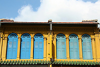 Peranakan architecture - shophouse is a vernacular architectural building type that is unique to Southeast Asia. This hybrid building form characterises many  towns in the region, especially Singapore.  Traditionally, many shophouses would have been plastered an off-white colour. Other popular early colours were indigo and ochre, given the range of available pigments. By the mid-20th century, pastel colours (rose pink, baby blue, light yellow, etc) became popular, and they remain the colours that most people most strongly associate with these buildings.