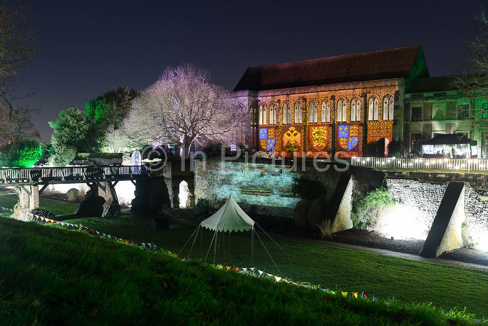 The gardens at Eltham Palace in Greenwich are illuminated for the Enchanted Eltham Palace event on December 14th 2017 in London, United Kingdom. The former Royal palace turned Art Deco mansion is one of six English Heritage properties taking part in its 'Enchanted' season of illuminated outdoor events which are happening at palaces, houses and castles across the country from Friday 15th - Saturday 23rd December. Inspired by Eltham's unique history, the gardens are spectacularly transformed into an illuminated world with its medieval heritage taking centre stage.