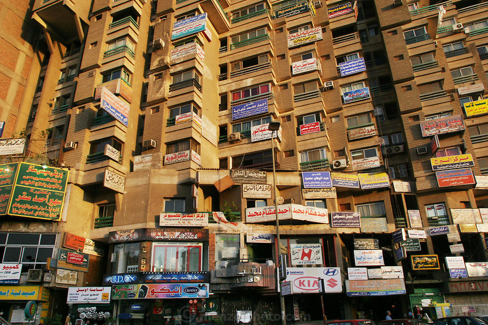 Apartment building with signs, Cairo, Egypt.