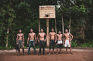Friends pose for a picture after a game of basketaball on a dirt court in a village outside Puerto Princesa on the island of Palawan in the Philippines. (July 4, 2019)