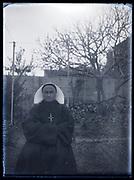 portrait of a nun sitting in a backyard France 1933