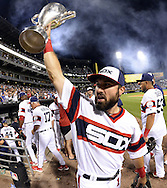 """CHICAGO - JULY 26:  Adam Eaton #1 of the Chicago White Sox reacts while hoisting the """"Crosstown Cup"""" after the White Sox defeated the Chicago Cubs on July 26, 2016 at U.S. Cellular Field in Chicago, Illinois.  (Photo by Ron Vesely)"""