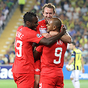 Spartak Moscow's Emmanuel Emenike (L), Ari (R) with team mates celebrating his goal during their UEFA Champions League Play-Offs, 2nd leg soccer match Fenerbahce between Spartak Moscow at Sukru Saracaoglu stadium in Istanbul Turkey on Wednesday 29 August 2012. Photo by TURKPIX