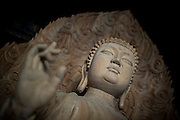 A wooden statue of Buddha is seen at the Buddhist Temple of Hua Yan in Datong, China, July 23, 2014.<br /> <br /> Confucianism, Taoism and Buddhism are the three major religions in China. Temples and statues witness their ancient roots all over the Chinese country.<br /> <br /> © Giorgio Perottino