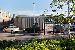© Licensed to London News Pictures. 05/05/2020. London, UK. Customers in their cars queue at a KFC drive thru restaurant in Greenford, on the A40. The fried chicken fast food chain has opened up more restaurants during the Covid-19 lockdown. Photo credit: London News Pictures