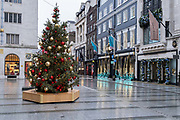 Four days before Christmas, retailers in Bond Street remain closed after the governments last-minute u-turn on the easing of Coronavirus pandemic rules. London and the South-East has been put under a Tier 4 restriction, forcing the closure of non-essential shops and small businesses, on 21st December 2020, in London, England.