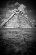 "Black and white photo of El Castillo, also known as the Temple of Kukulcan, the ""World Wonder"" in Chichen Itza archaeological site, Mexico"