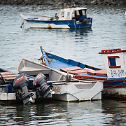 Wooden fishing boats on the waterfront of Panama City, Panama, on Panama Bay.