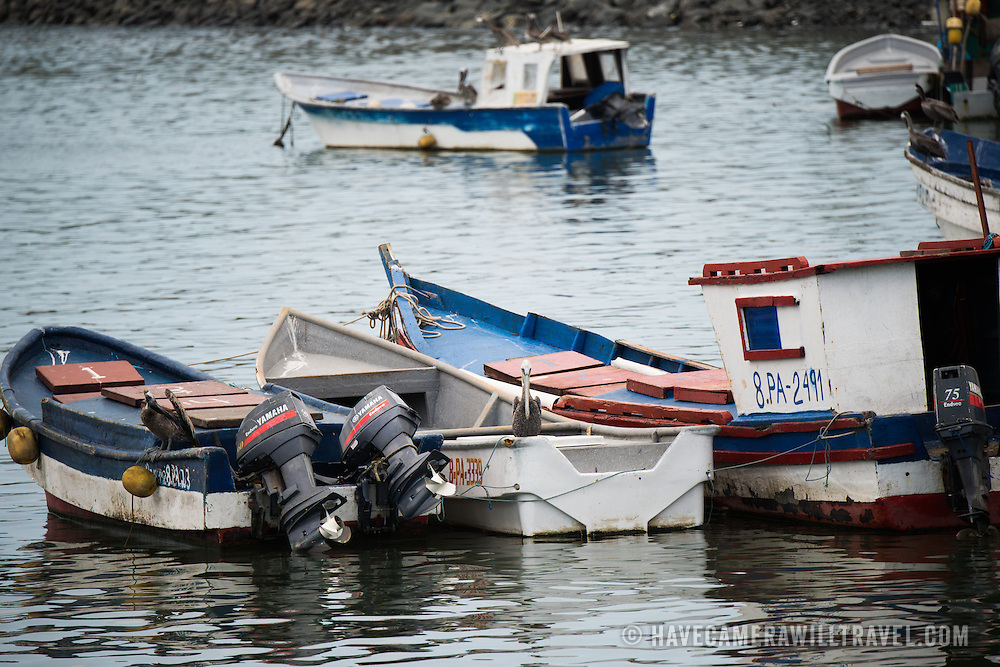 Wooden fishing boats on the waterfront of Panama City, Panama, on Panama Bay.