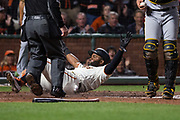 San Francisco Giants center fielder Denard Span (2) slides into home against the Pittsburgh Pirates at AT&T Park in San Francisco, California, on July 25, 2017. (Stan Olszewski/Special to S.F. Examiner)