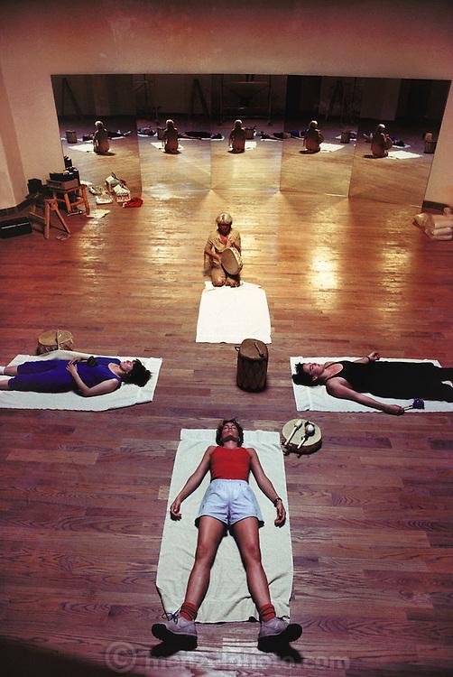 Vista Clara, health resort & spa. Santa Fe, New Mexico, USA. Meditating after exercise as the leader beats an Indian drum.