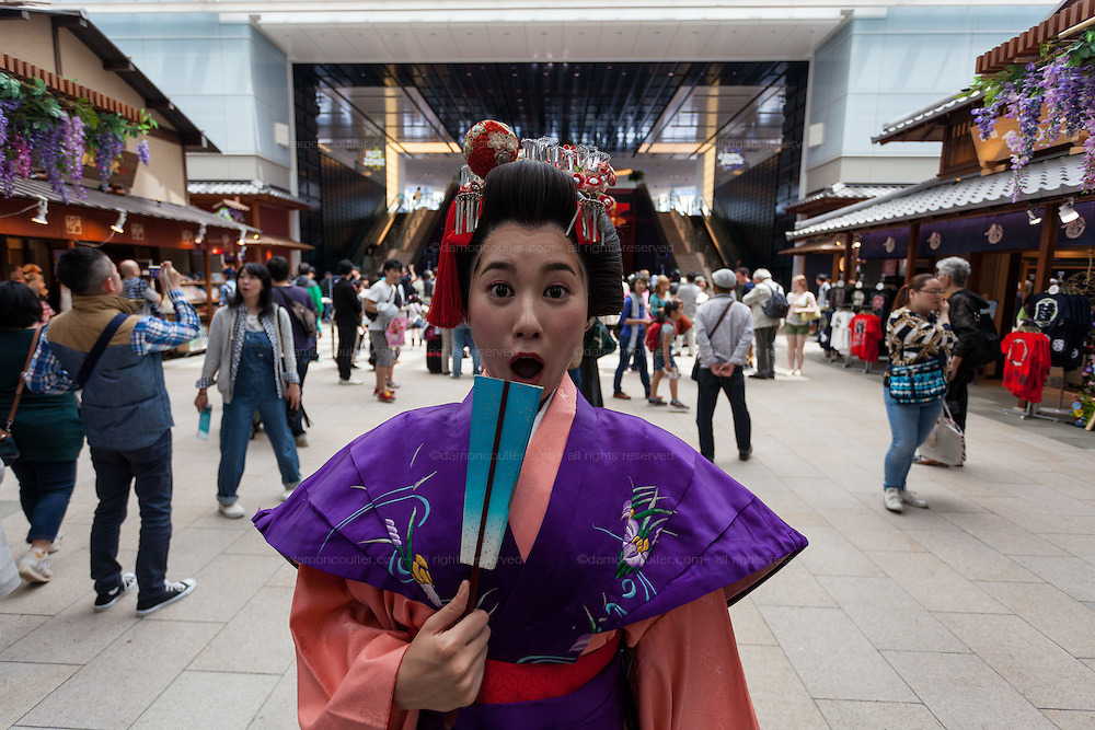An actor dressed as a Geisha from the Edo (samurai) Period to welcome visitors to Haneda International Airport, Tokyo, Japan. Tuesday May 3rd 2016. The Edo festival takes place over the three days of national holidays called Golden Week ( May 3rd to 5th) and features costume parades, music and stage shows along with other fun activities for visitors in and around the Edo themed shopping areas in the terminal building.