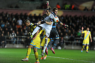Swansea city's Chico Flores looks to get on the end of a ball but is denied by Napoli keeper Rafael Cabral.UEFA Europa league match , Swansea city v Napoli at the Liberty Stadium in Swansea, South Wales on Thursday 20th Feb 2014. pic by Andrew Orchard, Andrew Orchard sports photography.