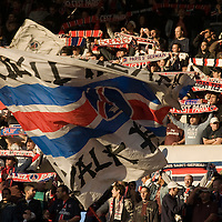11 March 2007: Supporters of the french soccer team Paris Saint-Germain (PSG) Football Club hold banners and flags of their group called Supras Auteuil in the Auteuil stands prior to the French League 1 football game won 1-0 by AJ Auxerre FC over Paris Saint-Germain (PSG) at the Parc des Princes stadium, in Paris, France.