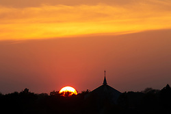 ©Licensed to London News Pictures 11/04/2020  <br /> Orpington, UK. An Easter sunset tonight with the steeple and cross of St Barnabas church in Orpington, South East London. Photo credit:Grant Falvey/LNP