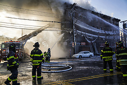 January 2, 2018 - Bronx, New York, United States - NDNY firefighters battle 7 alarm fire on Tuesday Jan. 2, 2018 in the Bronx, NY.Fire broke just before 6 am in Tuesday morning injuring at least 23 people. (Credit Image: © Go Nakamura via ZUMA Wire)