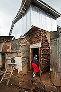 Nairobi, June 2010 -  The front door of the Saint Catherine's children's home with its new second-floor addition above the original mud stick structure.
