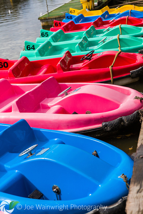 Colourful pedal boats moored on the River Dee, Chester