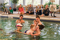 Instructor Martha McIntire passes Bryce back to his mother Amanda during their Water Babies/Grandbabies class in the Taylor Home Swimming Pool on Saturday morning.  (Karen Bobotas/for the Laconia Daily Sun)