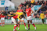 Cristhian Stuani, Derrick Wiliams, Nathan Baker during the Sky Bet Championship match between Bristol City and Middlesbrough at Ashton Gate, Bristol, England on 16 January 2016. Photo by Daniel Youngs.