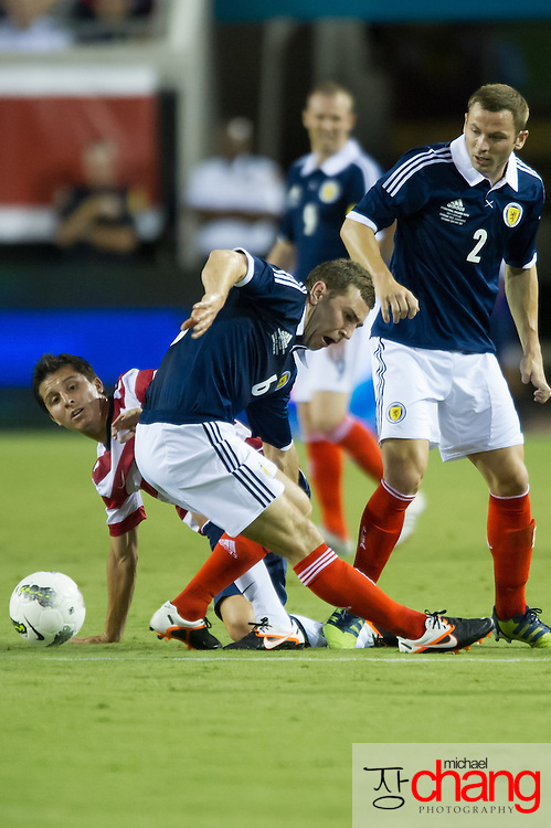 May 26 2012: USA's Jose Torres (16) attempts to steal the ball from Scotland's James McArthur (6) during the first half of play of the U.S. Men's National Soccer Team game against Scotland at Everbank Field in Jacksonville, FL. USA defeated Scotland 5-1.