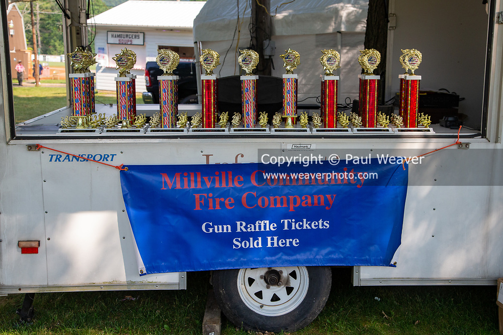 A banner advertising a gun raffle is seen at the Millville Community Fire Company carnival in Millville, Pennsylvania on July 5, 2021.