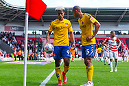 Lyle Taylor of Charlton Athletic (9) and Darren Pratley of Charlton Athletic (15) in action during the EFL Sky Bet League 1 play off first leg match between Doncaster Rovers and Charlton Athletic at the Keepmoat Stadium, Doncaster, England on 12 May 2019.