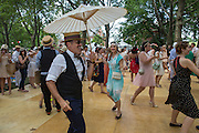 Dancers dance enthusiastically to the Deamland Orchestra.
