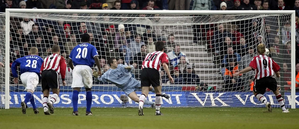 Photo. Aidan Ellis.<br /> Southampton v Everton.<br /> FA Barclaycard Premiership.<br /> 21/02/2004.<br /> Southampton's James Beattie sends Everton's Nigel Martyn the wrong way to score the second goal from the spot