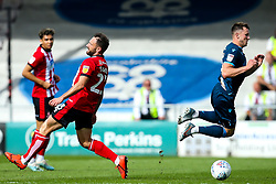 Ollie Clarke of Bristol Rovers is tripped by Neal Eardley of Lincoln City - Mandatory by-line: Robbie Stephenson/JMP - 14/09/2019 - FOOTBALL - Sincil Bank Stadium - Lincoln, England - Lincoln City v Bristol Rovers - Sky Bet League One