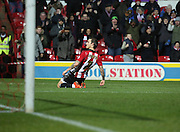 Brentford midfielder Sam Saunders celebrating scoring first goal of game during the Sky Bet Championship match between Brentford and Leeds United at Griffin Park, London, England on 26 January 2016. Photo by Matthew Redman.