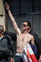© Licensed to London News Pictures . FILE PICTURE DATED 27/05/2013 of an EDL supporter giving a Nazi salute at an EDL demonstration in London as today (8th October 2013) Yaxley-Lennon and co-leader Kevin Carroll have announced they are leaving the group . Photo credit : Joel Goodman/LNP