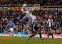 Photo: Richard Lane.<br />Birmingham City v West Bromwich Albion. The Barclays Premiership. 11/03/2006. <br />West Brom's Thomasz Kuszczak is fouled by Mikael Forssell.