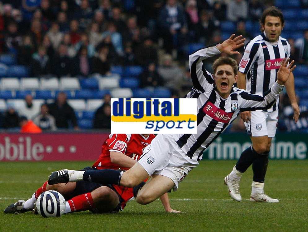 Photo: Steve Bond/Sportsbeat Images.<br /> West Bromwich Albion v Charlton Athletic. Coca Cola Championship. 15/12/2007. Zoltan Gera (R) is brought down by Matthew Holland (L)