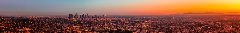 Panoramic view of Los Angeles at twilight, with Downtown L.A. to the left and the Pacific Ocean on the right. Los Angeles, California USA.