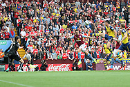 Ciaran Clark of Aston Villa (centre) leaps to head a cross, which is saved by Arsenal goalkeeper Wojciech Szczesny. Barclays Premier league match, Aston Villa v Arsenal at Villa Park in Birmingham on Saturday 20th Sept 2014<br /> pic by Mark Hawkins, Andrew Orchard sports photography.