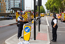 A large cordon surrounds the scene of a fire at The Mall in Walthamstow in North East London, that broke out during rush hour this morning and appears to have destroyed the foodcourt and according to a manager escorted by LFB officials at the adjacent Asda, a large amount of stock. London, July 22 2019.