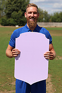 AFC Wimbledon midfielder Scott Wagstaff (7) holding Fifa sign during the AFC Wimbledon 2018/19 official photocall at the Kings Sports Ground, New Malden, United Kingdom on 31 July 2018. Picture by Matthew Redman.