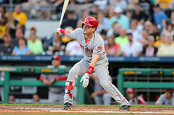 Jun 15, 2018; Pittsburgh, PA, USA; Cincinnati Reds second baseman Scooter Gennett (3) hits an RBI-sacrifice fly to center field during the third inning against the Pittsburgh Pirates at PNC Park. Mandatory Credit: Ben Queen-USA TODAY Sports