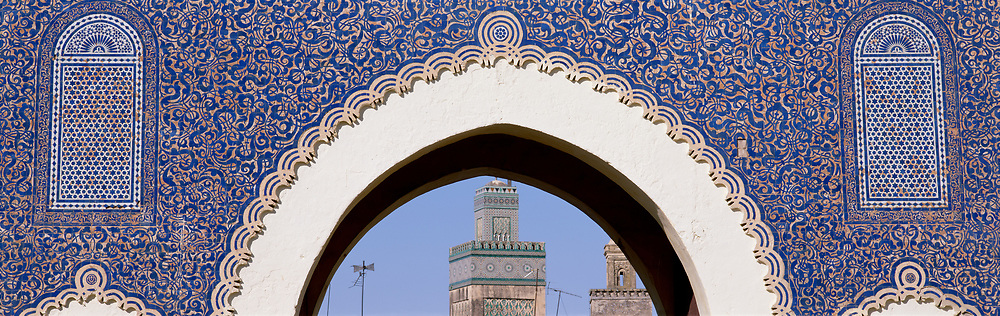 Blue Gate with white archway to city of Fez