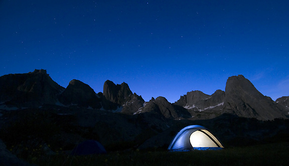 The first rays of moonlight illuminte the granite spires over a campsite in the Cirque of the Towers at twilight recently in the southeastern Wind River Mountains.