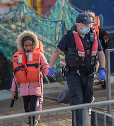 © Licensed to London News Pictures. 16/09/2021. Dover, UK.  Border Force officers assists migrants arriving at Dover Harbour in Kent. Migrants are continuing to attempt the crossing from France as the weather improves this week. Photo credit: Stuart Brock/LNP