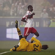 Bradley Wright-Phillips, New York Red Bulls, completes his hat trick as he slots the ball past Goalkeeper Stefan Frei, Seattle Sounders, during the New York Red Bulls Vs Seattle Sounders, Major League Soccer regular season match at Red Bull Arena, Harrison, New Jersey. USA. 20th September 2014. Photo Tim Clayton
